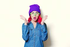 Girl in blue shirt, purple hat and green glasses stock photography