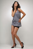 Girl in blue shirt and shorts. Royalty Free Stock Image