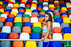 Girl in blue shorts workout on stadium Royalty Free Stock Image