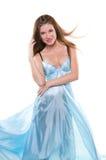 Girl  in the blue silk fabrics Royalty Free Stock Photos