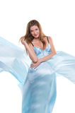 Girl  in the blue silk fabrics Royalty Free Stock Image