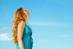 Girl and blue sky Royalty Free Stock Photos