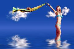 Girl on blue sky stock images