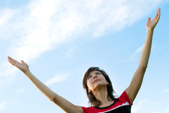 Girl and blue sky stock images
