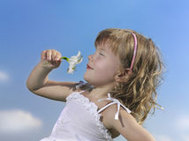 Girl  on blue sky. Girl on blue sky with flower Royalty Free Stock Image