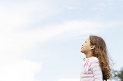 Girl with blue sky. Royalty Free Stock Photo