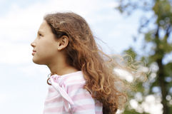 Girl with blue sky. Royalty Free Stock Photos