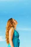 Girl and blue sky Stock Photos