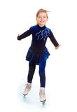 Girl in blue sport dress on skates. Stock Photos
