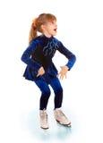 Girl in blue sport dress on skates. Stock Photo