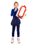 Girl in blue sport dress on skates with gift box. Stock Images
