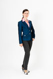 Girl in blue suit standing Stock Photography