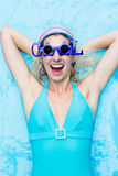 Girl in blue swimsuit Stock Photo