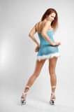 Girl in blue taking off, rear view Royalty Free Stock Photo
