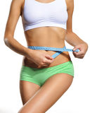 Girl with blue tape. Measure waist circumference Stock Image