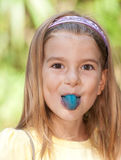 Girl with blue tongue Stock Photography