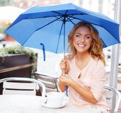Girl with blue umbrella Royalty Free Stock Image