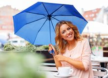 Girl with blue umbrella Royalty Free Stock Photography