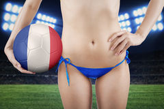 Girl with blue underwear holds ball Royalty Free Stock Photo