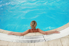 Girl in blue water pool in glasses Sun Protection Stock Photography