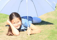 Girl in blue with white umbrella Stock Images