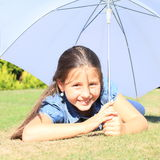Girl in blue with white umbrella Royalty Free Stock Photo