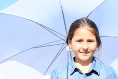 Girl in blue with white umbrella Royalty Free Stock Photos