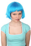 Girl in blue wig bitting her lip. Close up. White background Stock Images