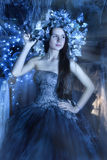 Girl in blue with a wreath Stock Images