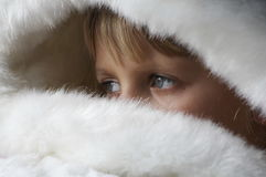 Girl blue yes in the white fur Stock Photography