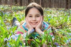 Girl among the bluebells Stock Image