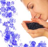 Girl with blueberries. Beautiful girl with a handful of blueberries Stock Image