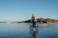 Girl on a bmx on ice. Stock Photo