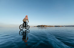 Girl on a bmx on ice. Royalty Free Stock Photo
