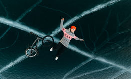 Girl on a bmx on ice. Stock Photos