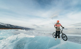 Girl on a bmx on ice. Royalty Free Stock Images