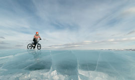 Girl on a bmx on ice. Royalty Free Stock Image
