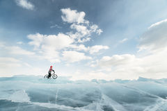 Girl on a bmx on ice. Royalty Free Stock Photography