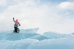 Girl on a bmx on ice. Stock Photography