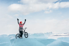 Girl on a bmx on ice. Royalty Free Stock Photos