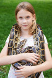 Girl with boa constrictor Stock Photos