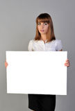Girl with board. Women hold blank white board Stock Images
