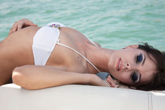 The girl on a boat. The beautiful girl lies on a boat and has a rest Royalty Free Stock Photography