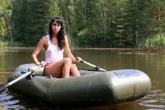 Girl in boat Stock Images