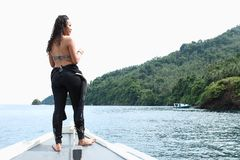 Girl on boat in Lembeh Strait stock image