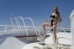 The girl on the boat. A pretty woman in bikini sunbathing on the boat Royalty Free Stock Images