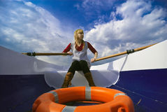 Girl in a boat rowing Royalty Free Stock Images