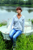 Girl on the boat. Girl sitting on a boat Stock Photography