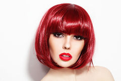 Girl with bob hair cut. Portrait of young beautiful sexy red-haired girl with bob haircut and stylish make-up Stock Photos