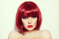 Girl with bob hair cut. Vintage style portrait of young beautiful sexy red-haired girl with bob haircut and stylish make-up Royalty Free Stock Images